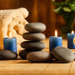 Spa still life with hot stones and candles — Stock Photo #49487033