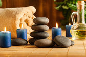 Spa still life with hot stones and candles — ストック写真