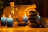 Spa still life with hot stones and candles — Stockfoto