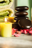 Spa still life with hot stones and candles — Стоковое фото