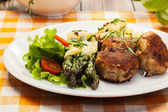 Meatballs served with boiled potatoes and asparagus — Stock Photo