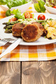 Meatballs served with boiled potatoes and asparagus — Photo
