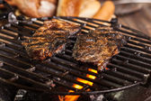 Grilling marinated pork meat on a charcoal grill — Stok fotoğraf