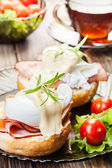 Eggs Benedict on toasted muffins with ham — Stok fotoğraf