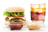 Chickenburger and glass of cola with ice — Stock Photo