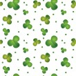 Green seamless clover pattern — Stock Vector