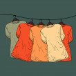 Background of shirts on hangers — Stock vektor