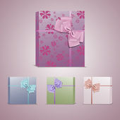 Set of colorful gift boxes with bows and ribbons — Stock Vector