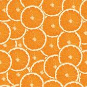 シームレスなオレンジ色のスライスの背景 — ストックベクタ