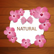 Vector frame with pink spring flowers and bow — Stock Vector