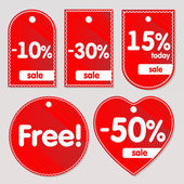 Vector red sale labels — Stock Vector