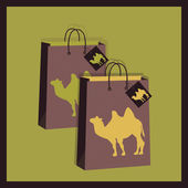 Shopping bags with camel illustration — Stockvector