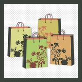 Vector floral shopping bags — Stock Vector