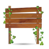 Wooden Board Surrounded by Clovers — Stock Vector