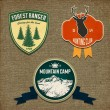 图库矢量图片: Set of outdoor adventure badges and hunting logo emblems