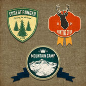 Set of outdoor adventure badges and hunting logo emblems — Stok Vektör