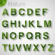 Green Leaves font. — Vettoriale Stock