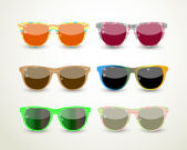 Set of multicolored glasses — Vector de stock