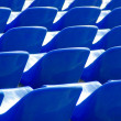 Many dark blue armchairs in sports stadium — Stock Photo #32714299