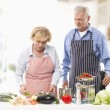 Stock Photo: Senior Couple Cooking In Kitchen