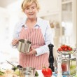Senior Woman Cooking In The Kitchen — Stockfoto