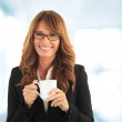Businesswoman having a coffebreak — Stock Photo #23540161