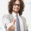 Successful business man gives you a thumbs up — Stock Photo #23559211