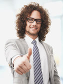 Successful business man gives you a thumbs up — Stock Photo