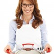 Pretty housewife holding a wok — Stock Photo