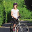 Young girl mountain biking — Stockfoto