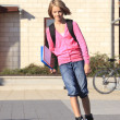 图库照片: Girl roller skating to the school