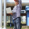 Foto Stock: Engineer in hardhat with laptop