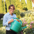 Beautiful mature woman gardening — Stock Photo #23562839