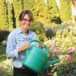Beautiful mature woman gardening — Εικόνα Αρχείου #23562839