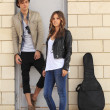 Foto Stock: Young couple with acoustic guitar