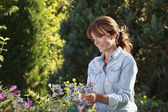 Beautiful mature woman gardening — Stock Photo