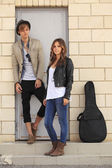 Young couple with acoustic guitar — Stock Photo