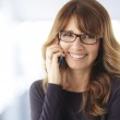 Mature woman talking on phone — Stock Photo