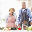 Senior Couple Cooking In Kitchen — Stock Photo #23912511