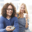 Stock Photo: Young Couple Watching Television on Couch