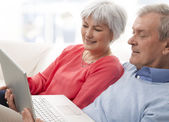 Close-up of a senior couple using laptop — Stock Photo