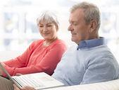 Close-up of a senior couple using laptop — Stock Photo