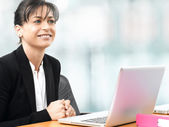Business woman smiling in office — Stock Photo
