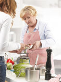 Two Women cooking In The Kitchen — Stock Photo