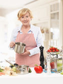 Senior Woman Cooking In The Kitchen — Stock Photo
