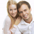 Portrait of a happy couple sitting together — Stock Photo