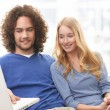 Portrait of a happy couple sitting together — Stock Photo #24796381