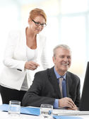 Businessman and Woman working on — Stock Photo