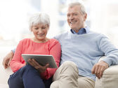 Senior Couple With Digital Tablet — Stock Photo