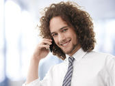 Young handsome guy enjoying a telephonic conversation — Stock Photo